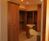 master-suite-walk-in-closet-with-built-in-ironing-storage